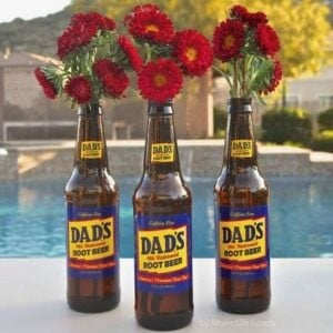 glass bottles with red flowers inside
