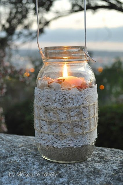 Mason jar lanterns. These pretty diy mason jar lights are easy to make and perfect for adding ambience to a party, bridal shower, reception, or wedding!