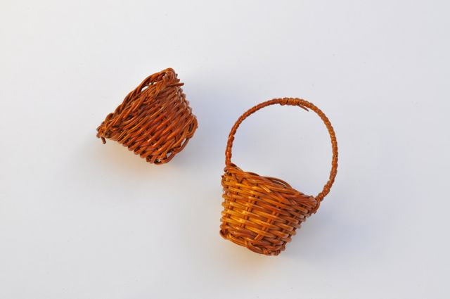 Use scissors to cut handle off each basket