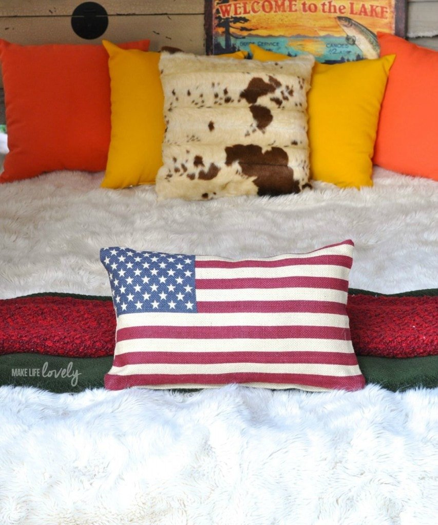 Glamping Bed with lots of pillows and blankets | by Make Life Lovely
