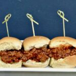 three buns with sloppy Joe meat inside