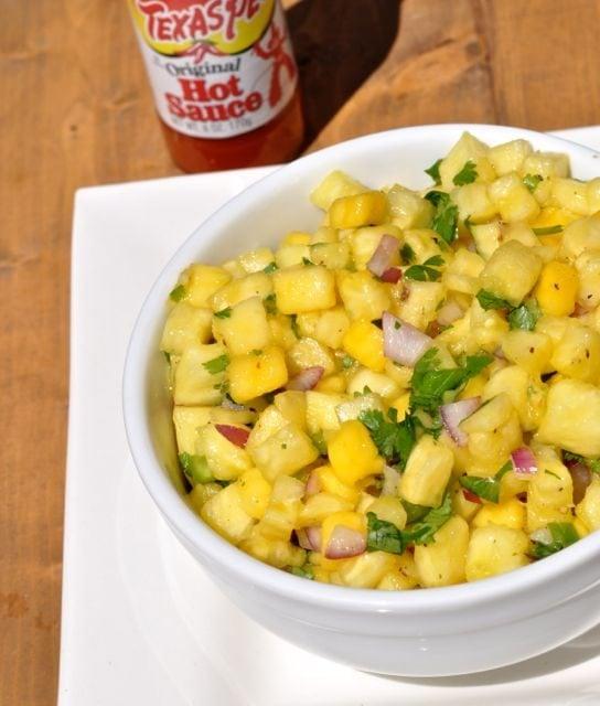 mango pineapple salsa in white bowl