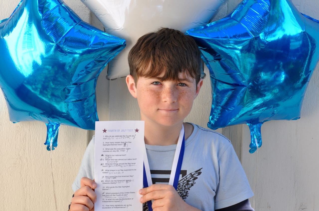 boy holding paper