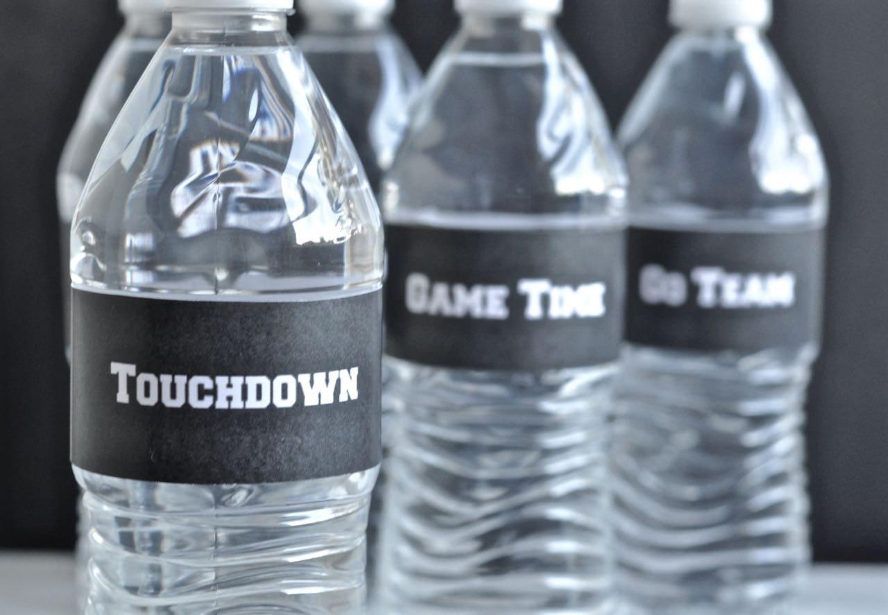 black football labels on water bottles