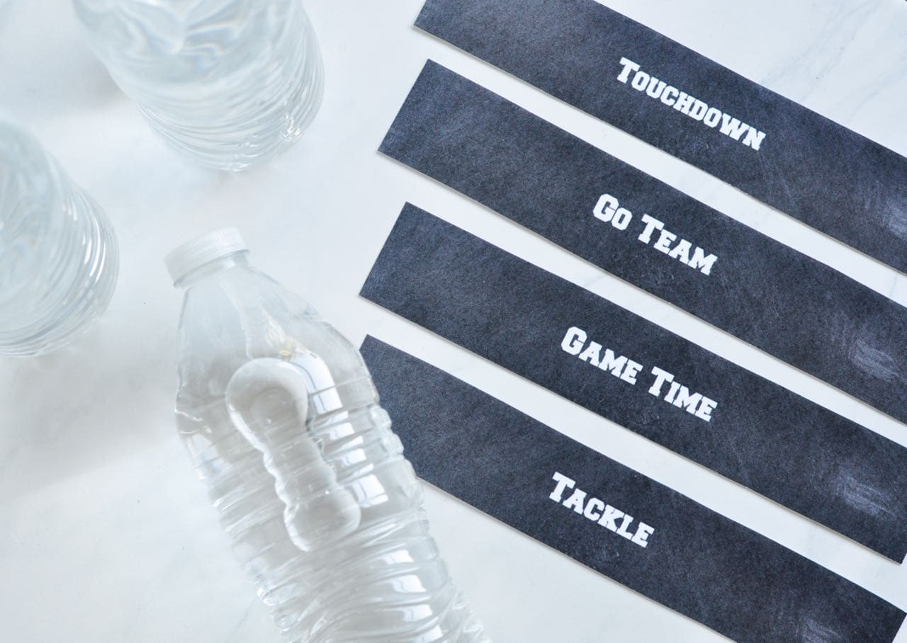 black football labels by water bottles