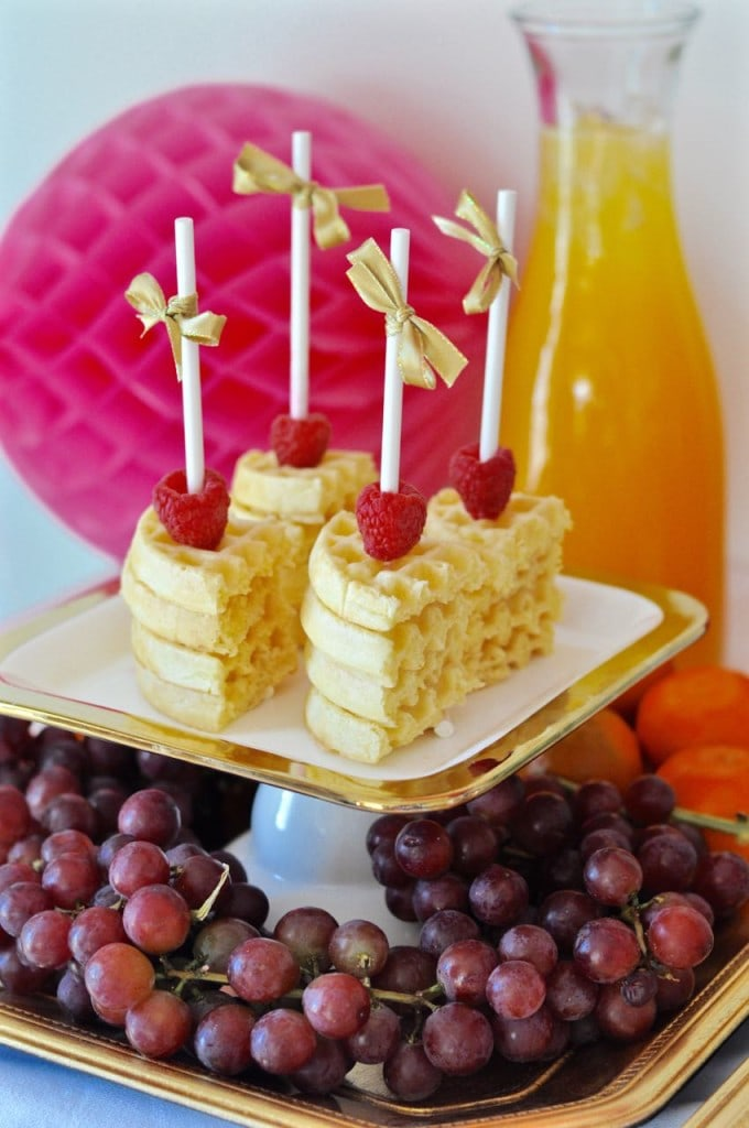 Waffles and fruit at a brunch party