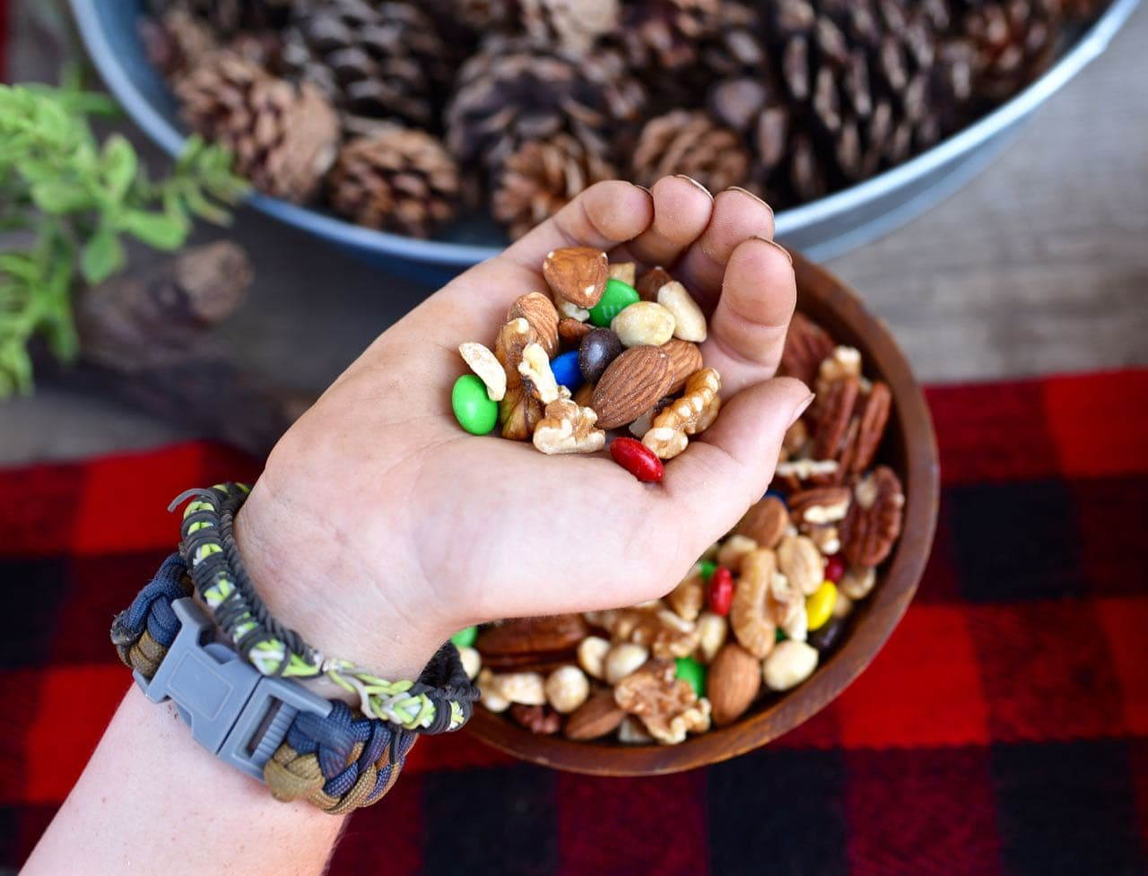 Eating trail mix at the backyard camping party