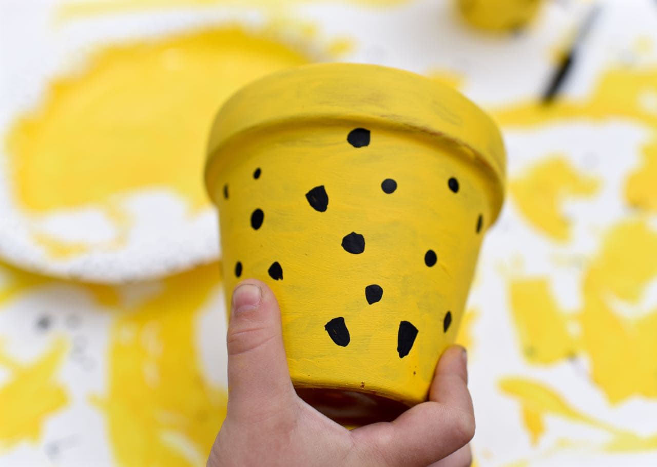 Adding polka dots to the DIY pineapple planters