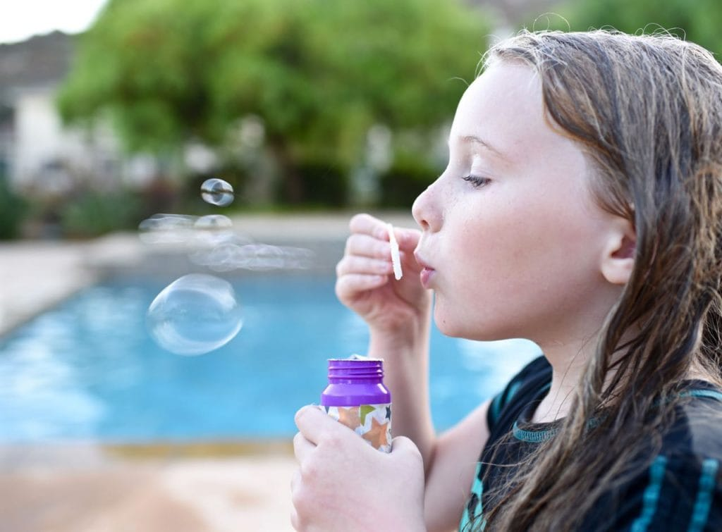 Blowing bubbles at a summer party for kids