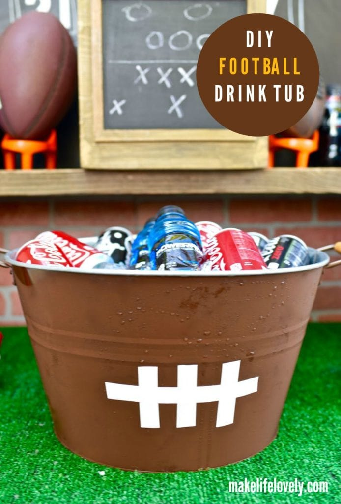 DIY football drink tub. Make one of these easy football drink tubs for your next football game viewing party!