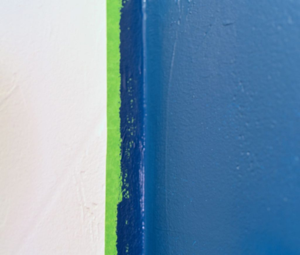 Navy blue accent wall with Frog Tape