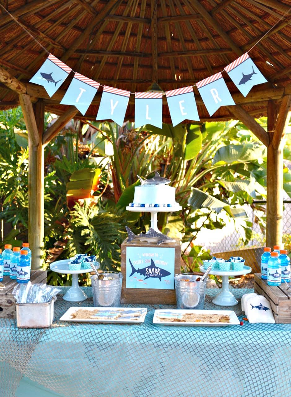 This Shark Themed Birthday Party Decor Is Reminiscent Of A Beach House