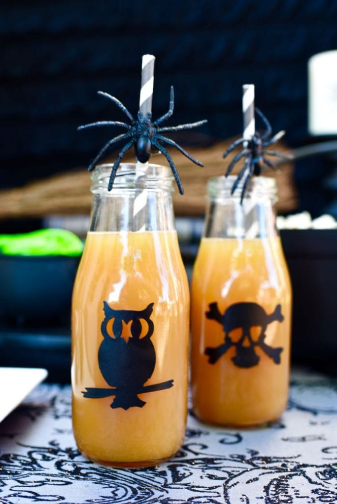 Halloween milk glass bottles at witch themed Halloween party