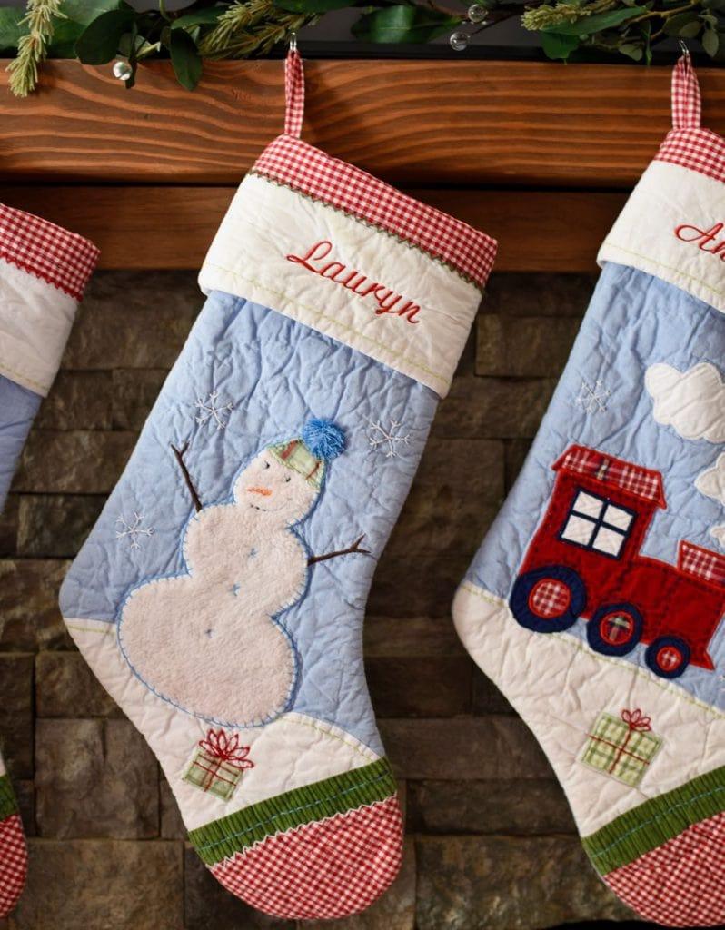 Christmas living room stockings and fireplace