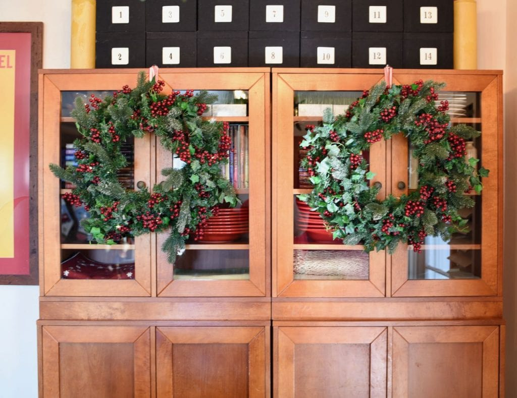 Hutch with wreaths in Christmas living room