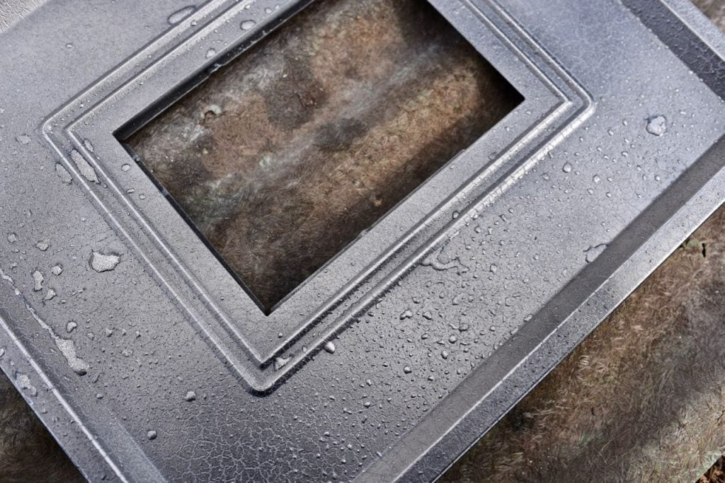 Water drops on the mercury glass frame