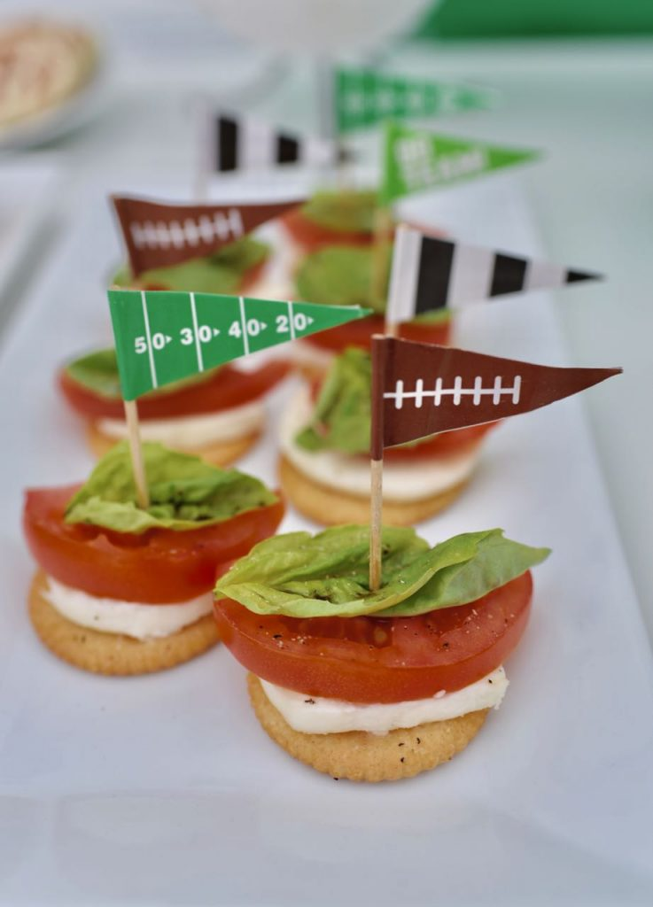Caprese crackers appetizer for a football party. So delicious and easy to make!