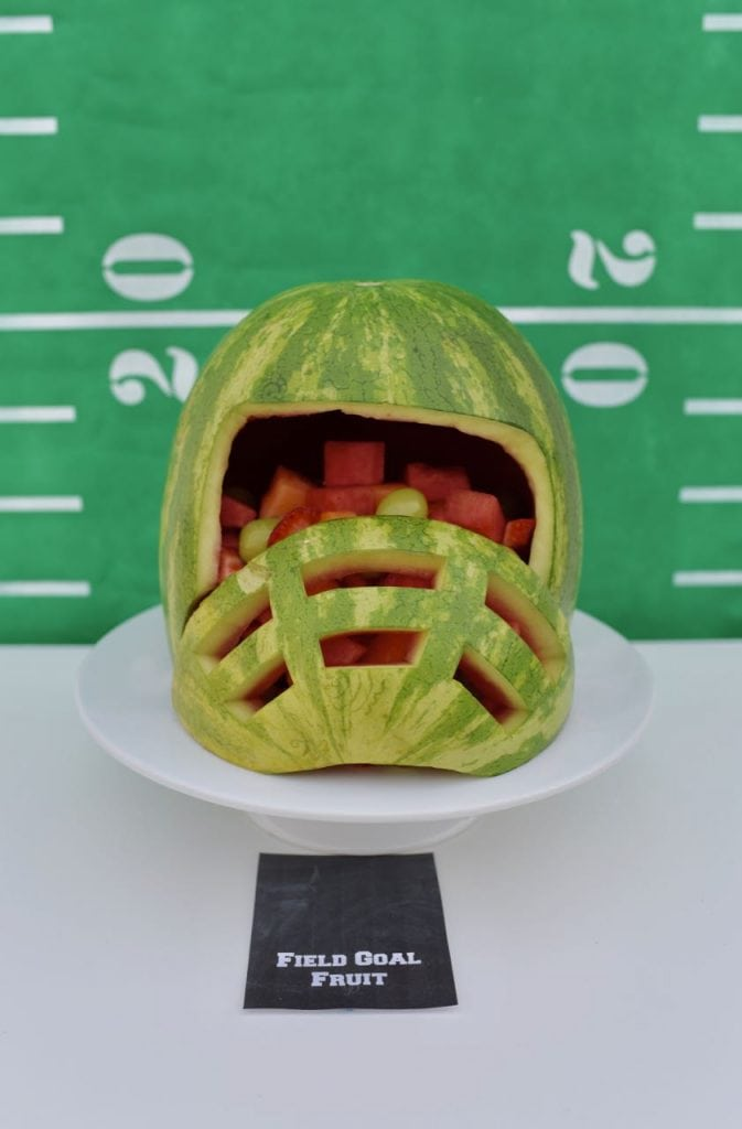 Football helmet watermelon. Such a fun way to serve fruit for a football or Super Bowl party!