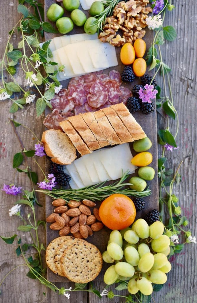 simple charcuterie board with meat, cheese, bread, fruit