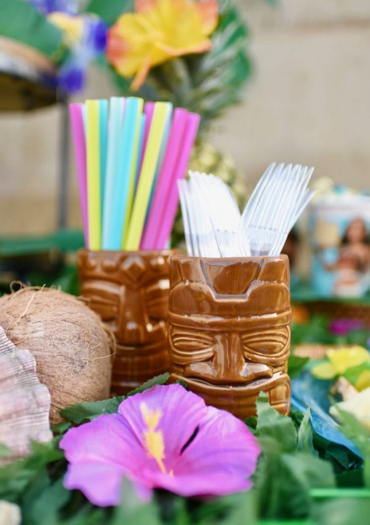 Cute Moana party! Serve straws and utensils in ceramic tiki cups.