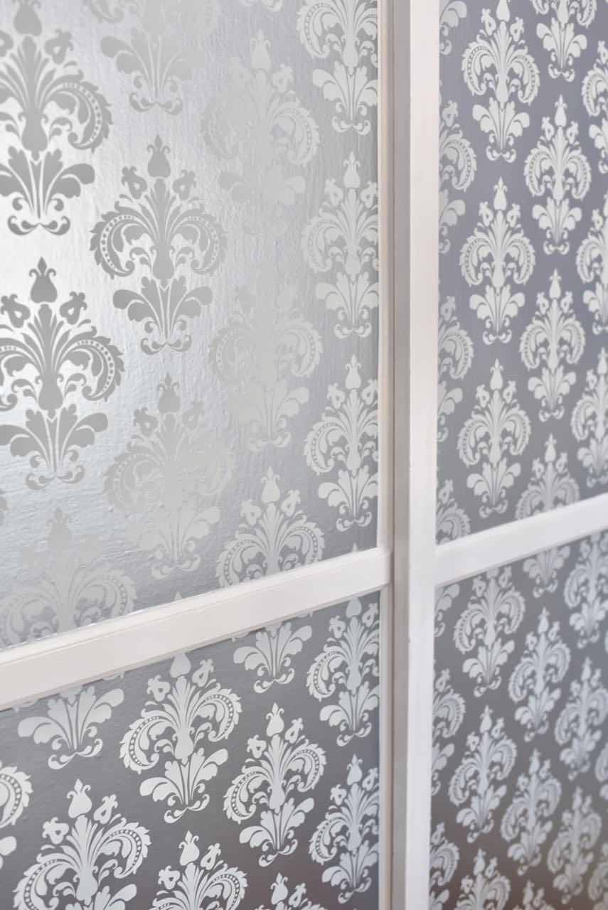 Closet Makeover With Wallpaper On Doors