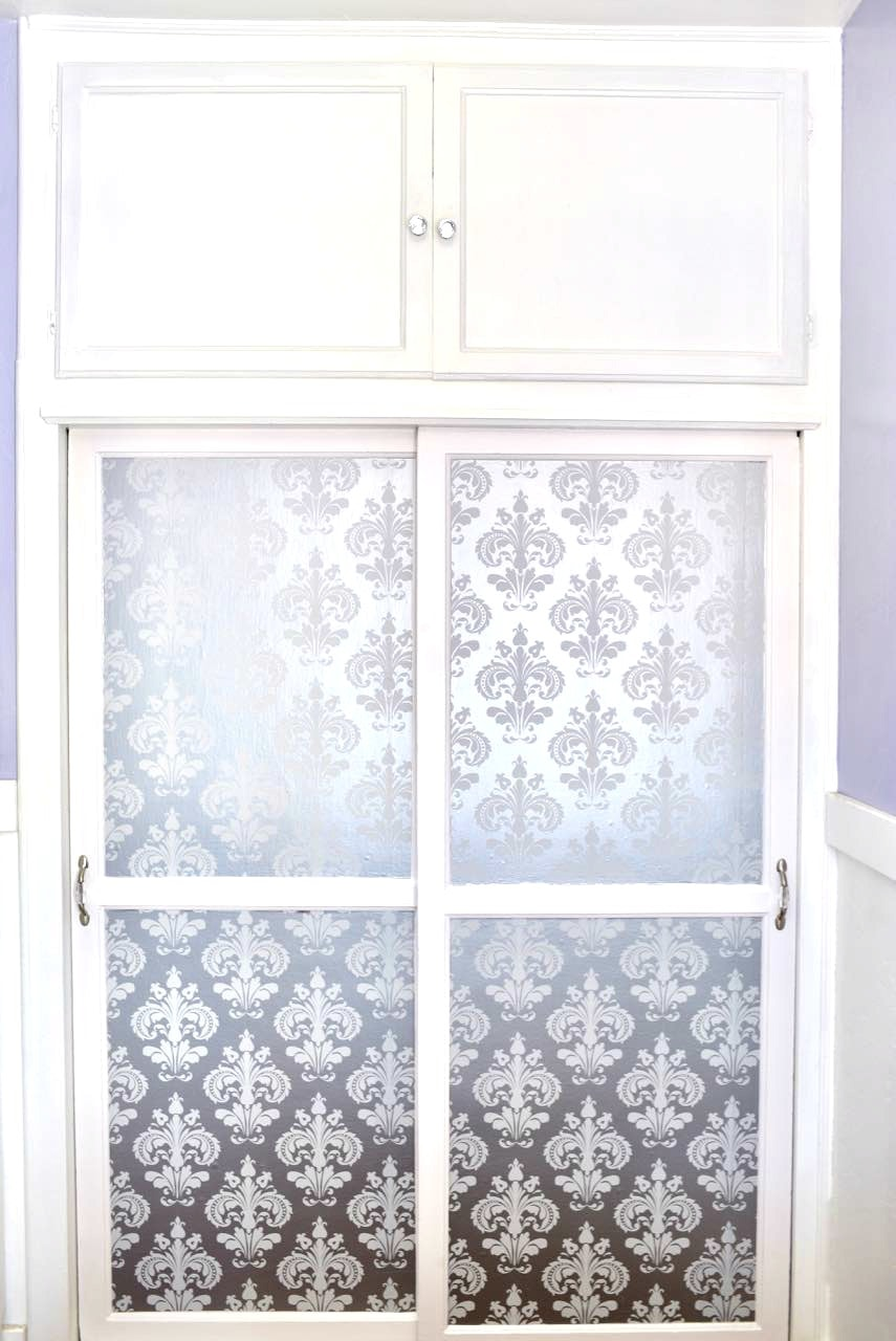 S Closet Makeover With Wallpaper On Doors