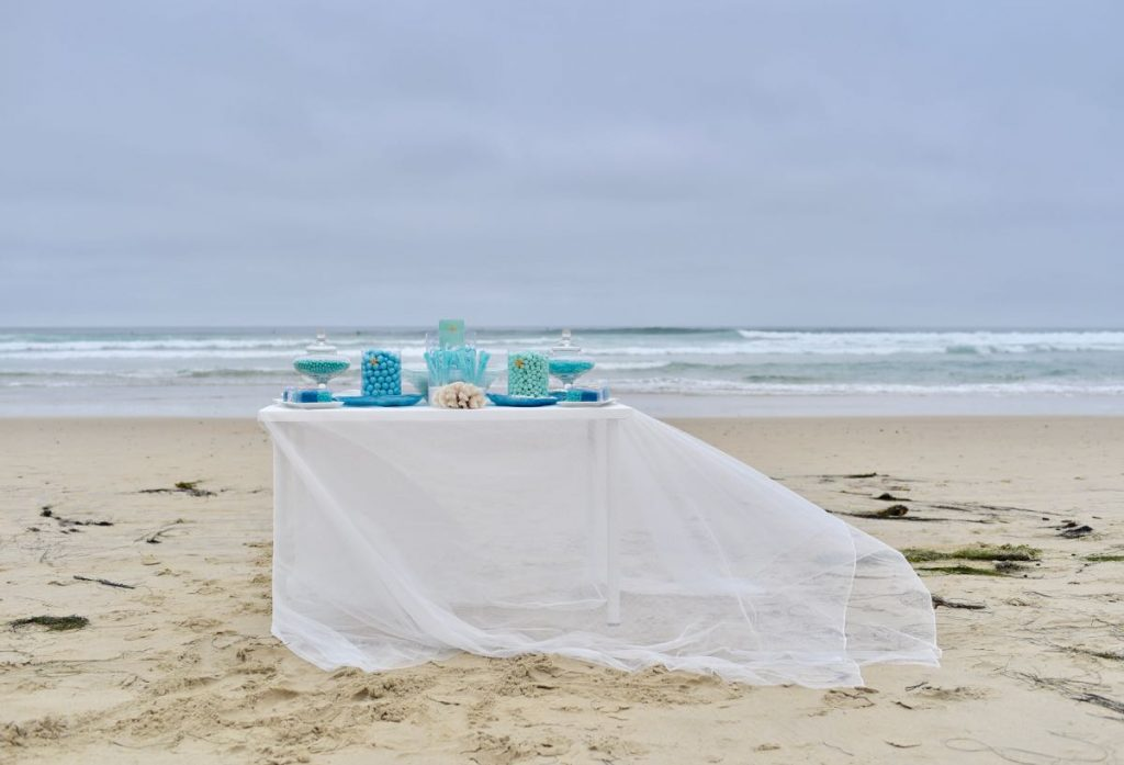 Blue and turquoise candy buffet at beach wedding