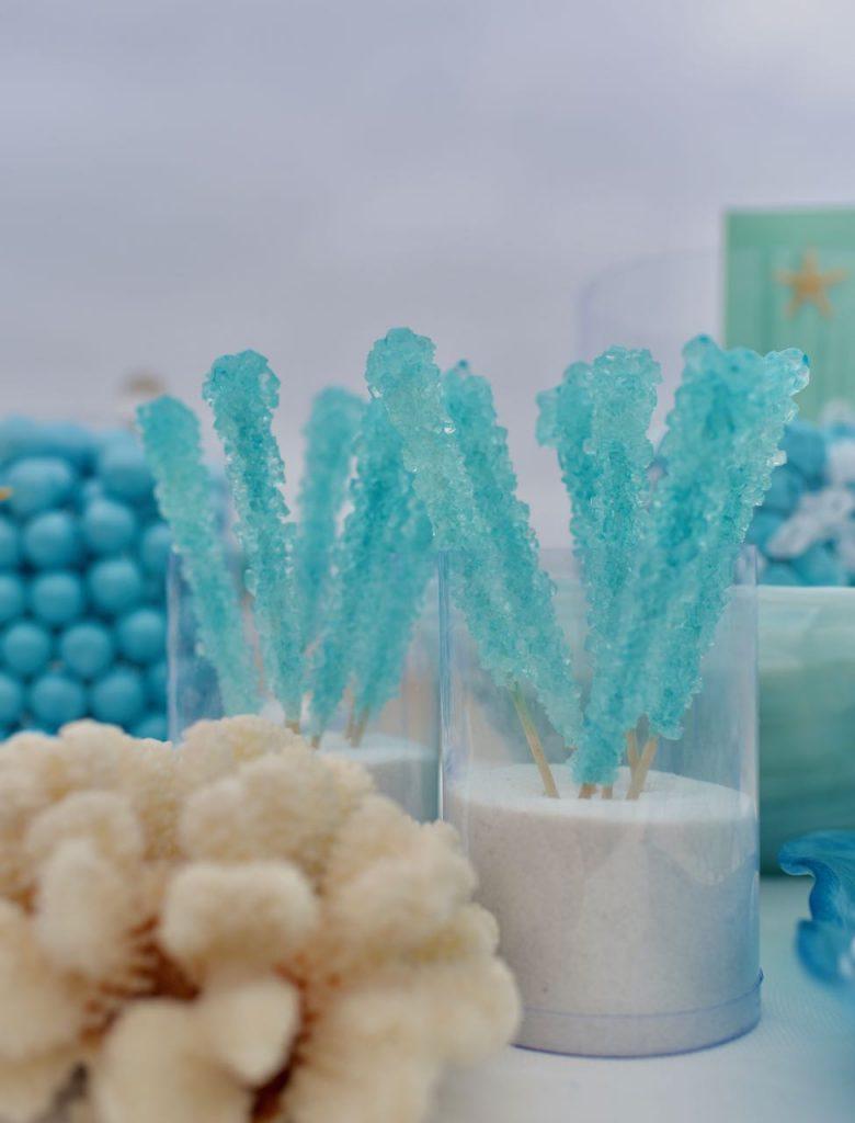 Blue rock candy at beach wedding candy buffet