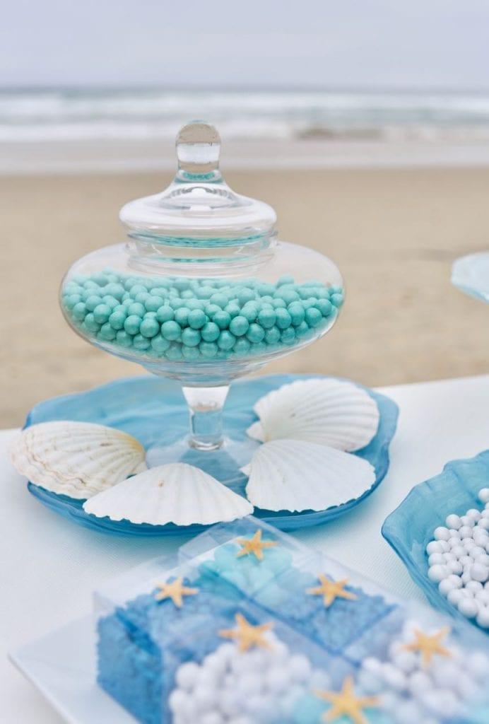 Nautical wedding blue candy buffet at beach