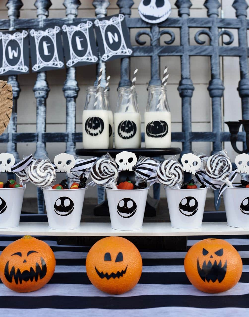 nightmare before christmas party favor pails with candy and vinyl jack skellington