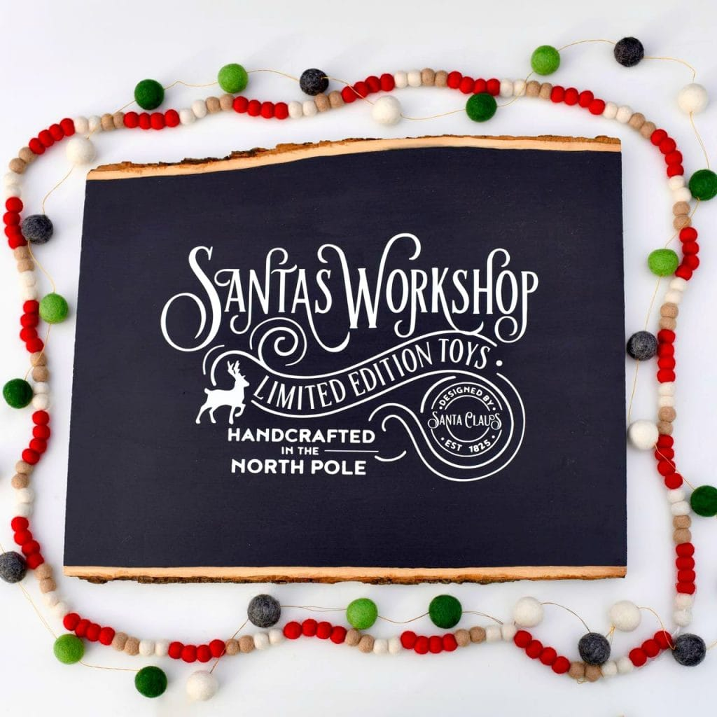 Christmas chalkboard sign with vinyl and Cricut machine