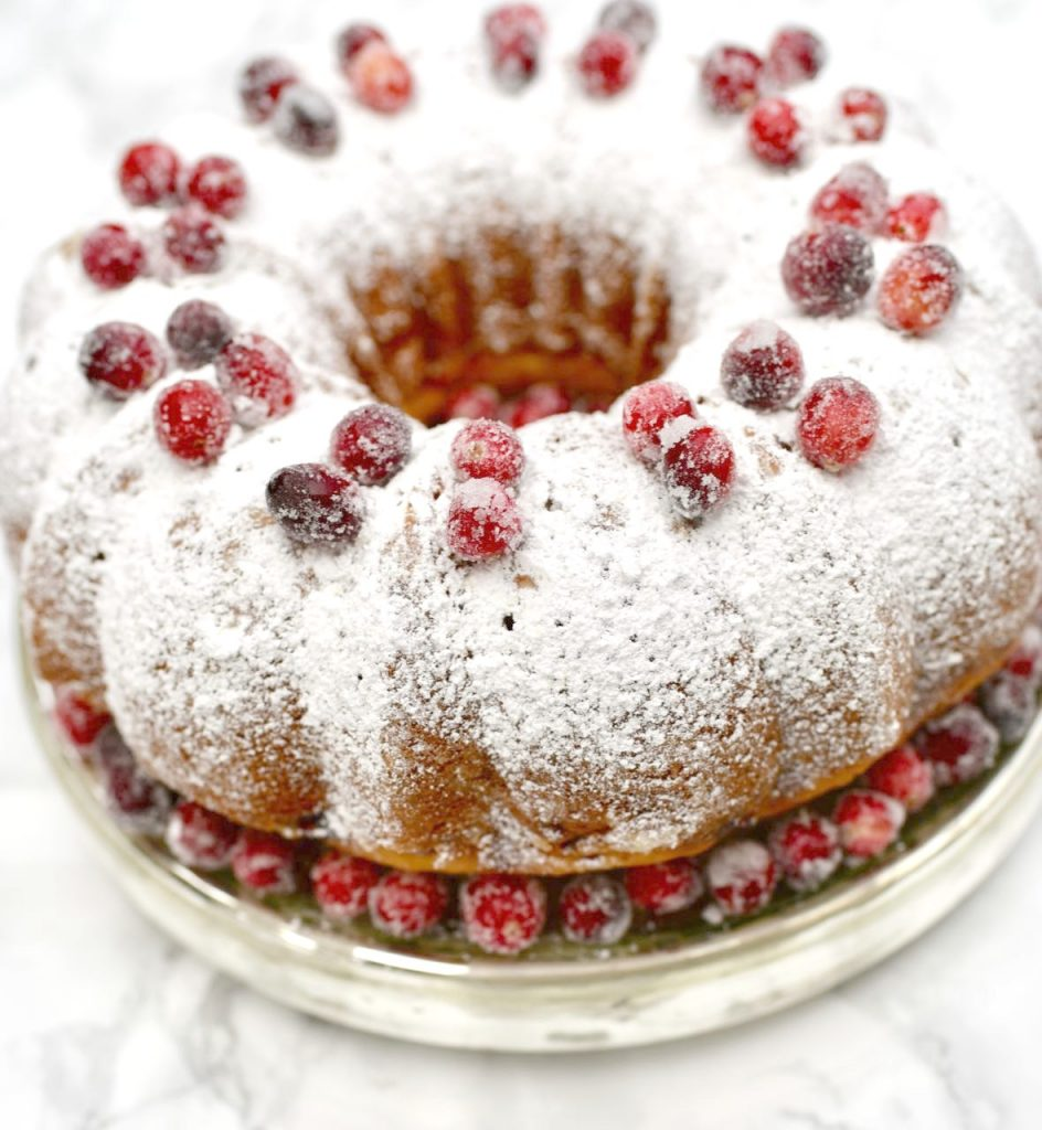 Orange cranberry bundt cake Christmas dessert with sugared cranberries