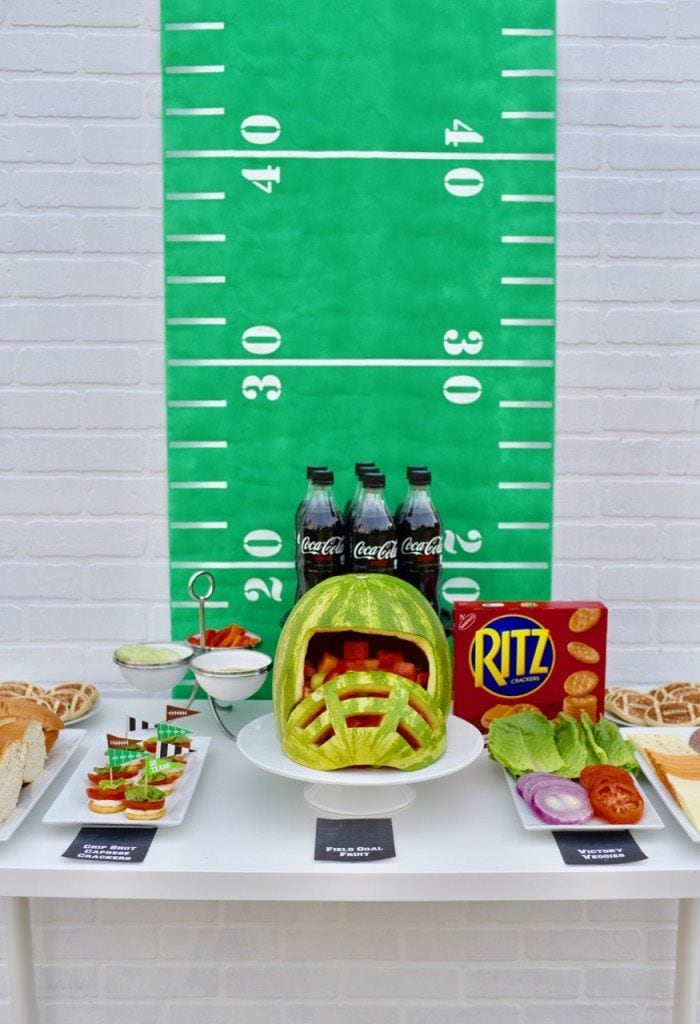 Healthy football party with amazing watermelon helmet! Perfect food for a Super Bowl party.