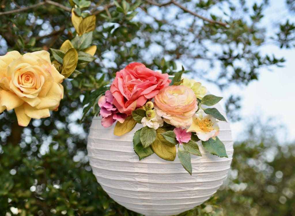DIY floral paper lanterns tutorial. These are so beautiful and will last forever since they are made from silk flowers.