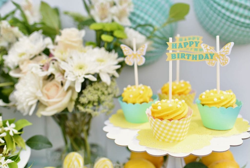 Butterfly cupcakes at yellow birthday party with Cricut cupcake toppers