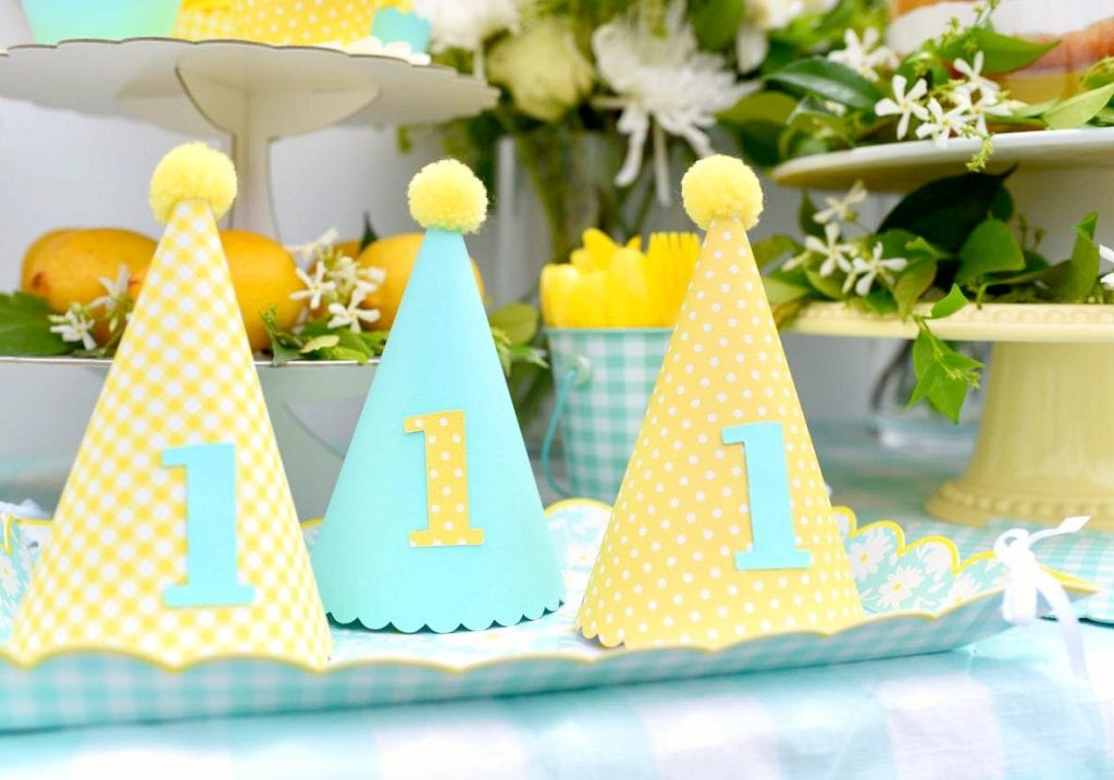 Martha Stewart Cricut party hats at yellow birthday party