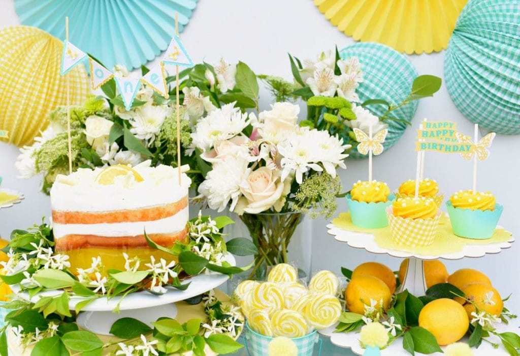 Outdoor garden yellow birthday party with Cricut cupcake toppers and Martha Stewart Meyer Lemon supplies for one year old