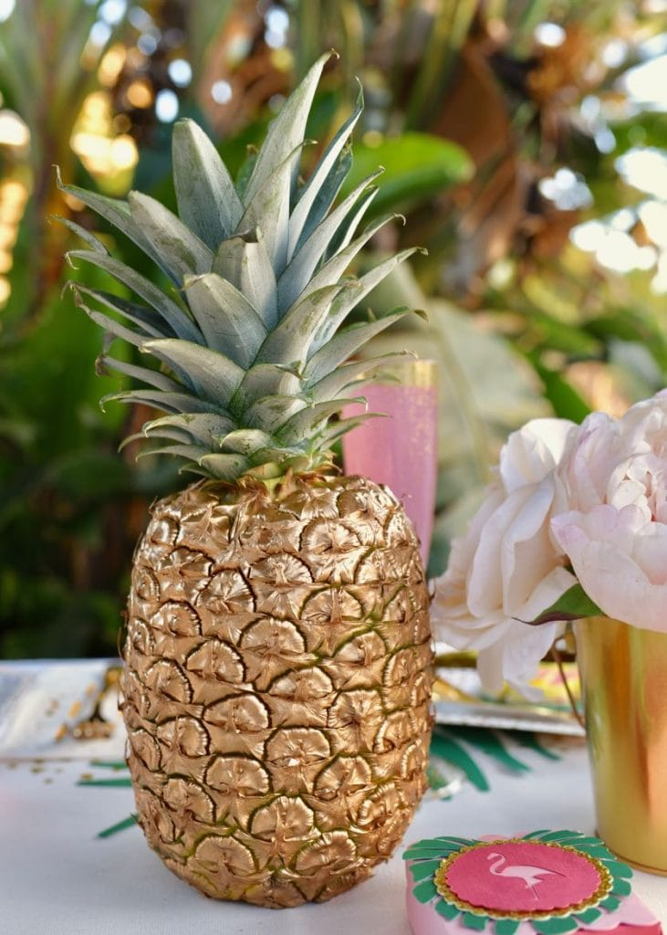 Gold spray painted pineapple at a tropical baby shower