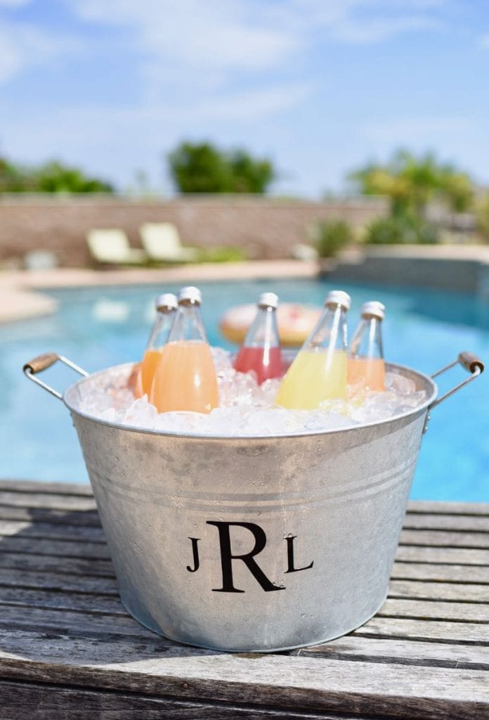 DIY monogram ice bucket with vinyl and Cricut machine. Personalize your ice bucket for parties and entertaining in just 10 minutes! This personalized ice bucket also makes a great birthday or wedding gift!