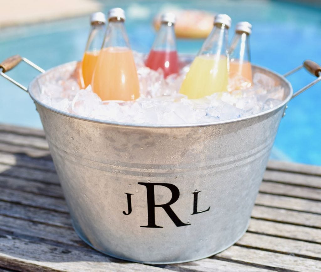 How to add a monogram to an ice bucket, perfect for summer parties and entertaining! A personalized ice bucket also makes a great gift.