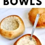 Easy homemade bread bowls filled with soup and a spoon