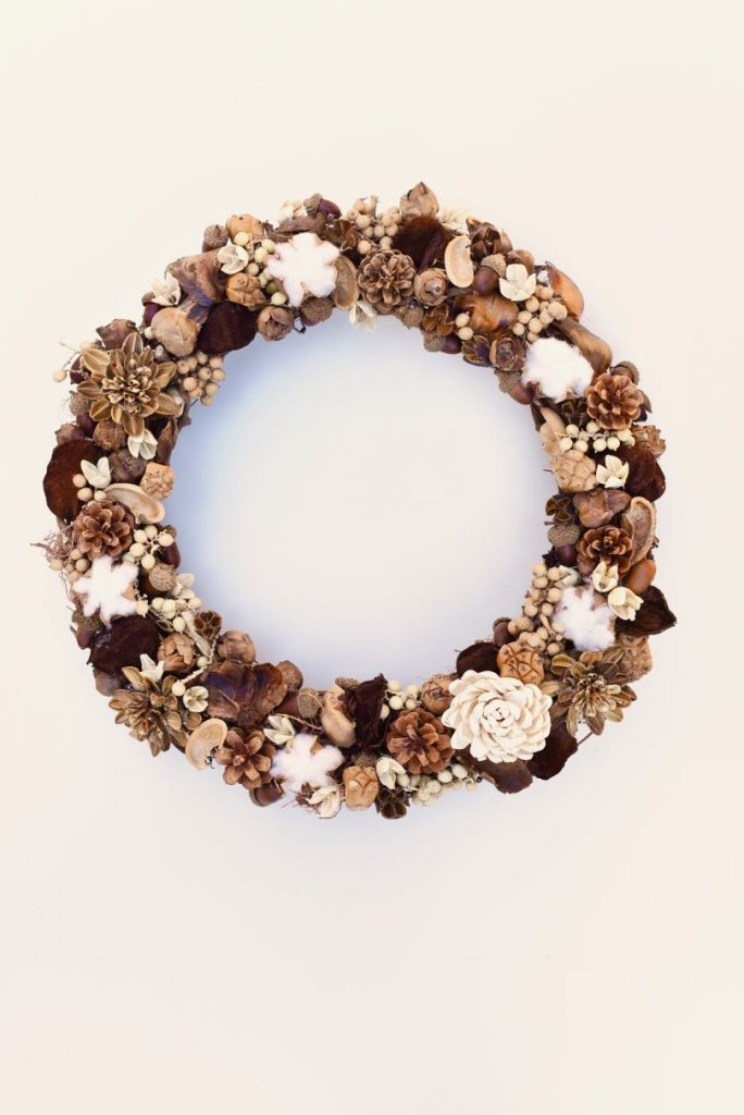 How to make a fall wreath. Make a stunning DIY fall wreath for just a few dollars that's made from nature. Great for a Thanksgiving decoration too!