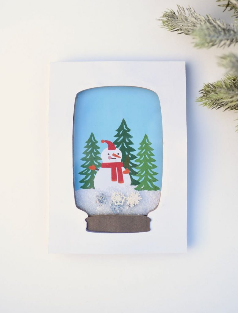 How to make snow globe DIY Christmas cards. Make adorable shaker style snow globe holiday cards that really shake! Get the FREE Cricut file + instructions.