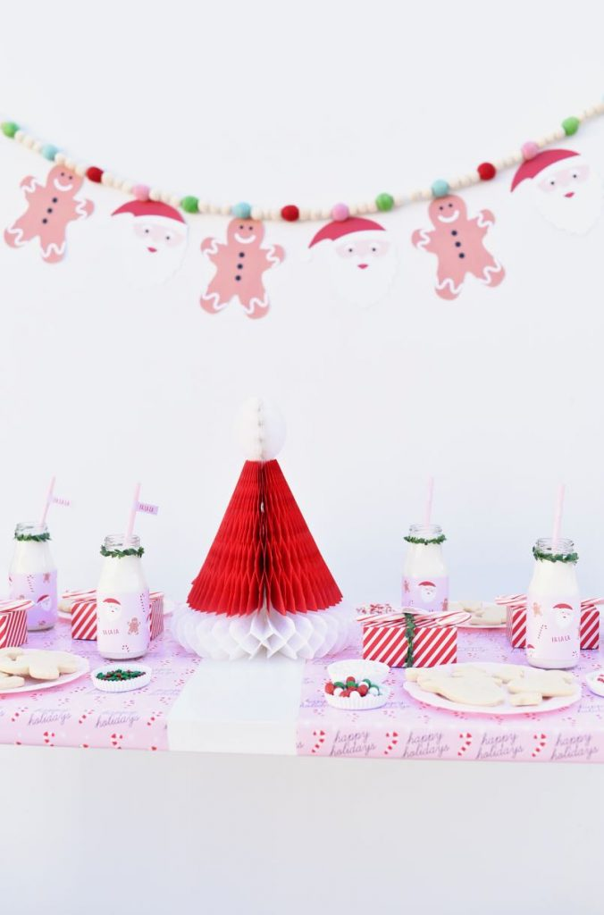 Plan the ultimate Christmas cookie decorating party with these tips + FREE printables! Get free printable cookie party invitations, bottle wraps, favor tags, and garland.