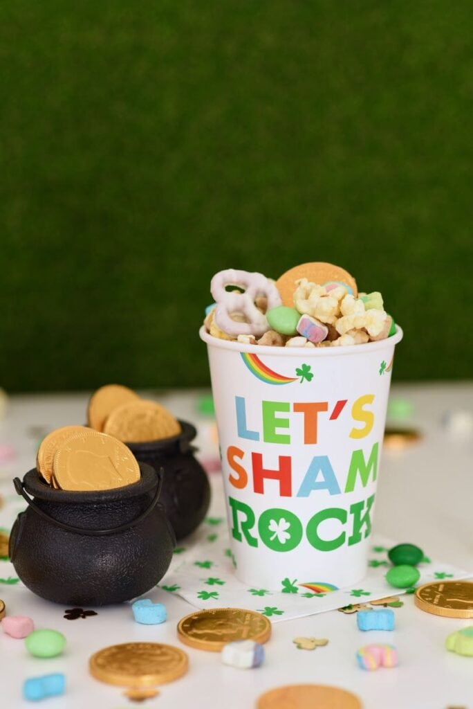 leprechaun food snack mix with popcorn, gold coins, Lucky Charms cereal, and green M&Ms