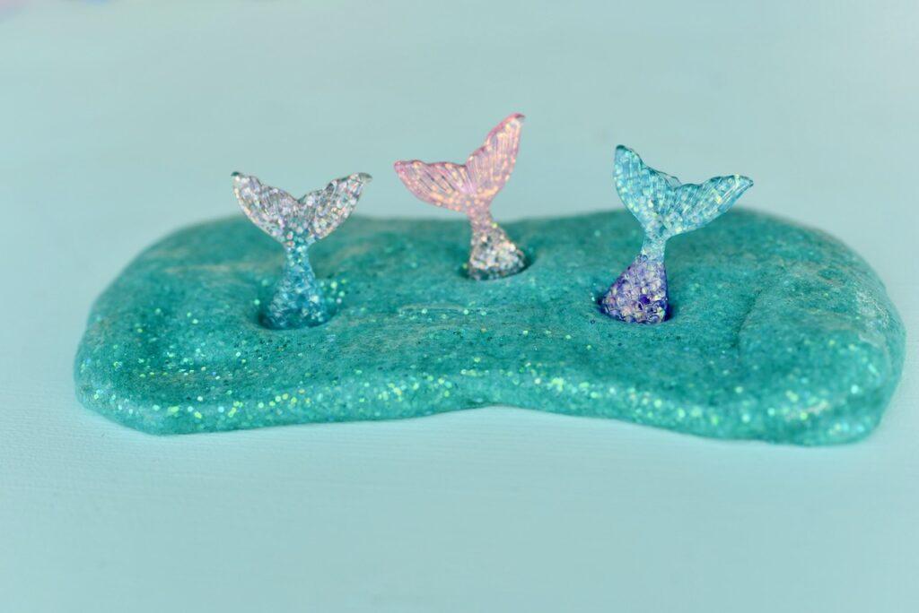 Glitter mermaid slime with three mermaid tails