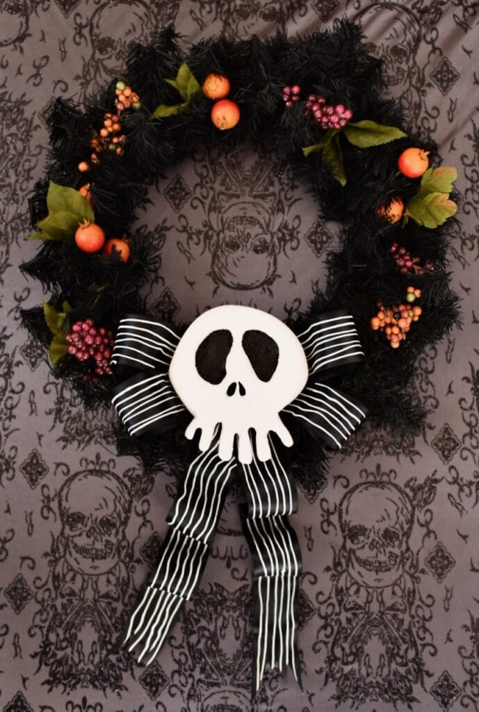 black nightmare before christmas wreath with white skull and black bow