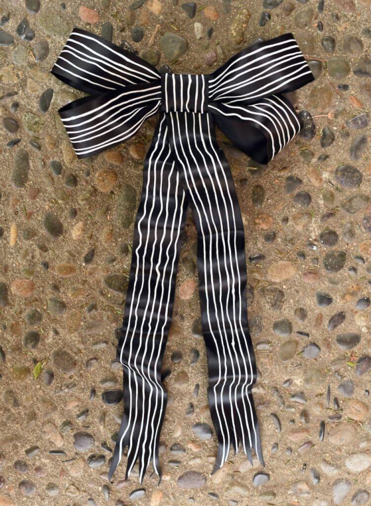 black wreath with thin white stripes