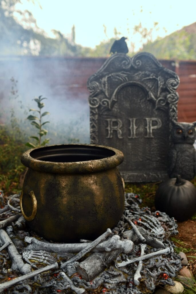 Fake fire with bones, cauldron, and headstone