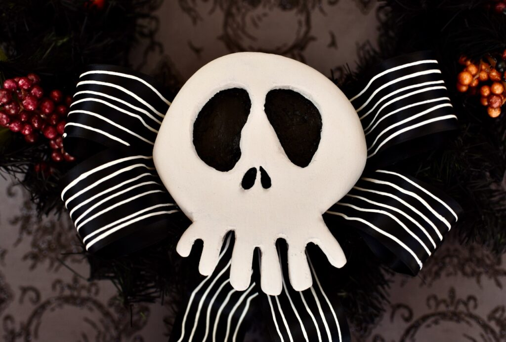 white nightmare before christmas skull with black bow